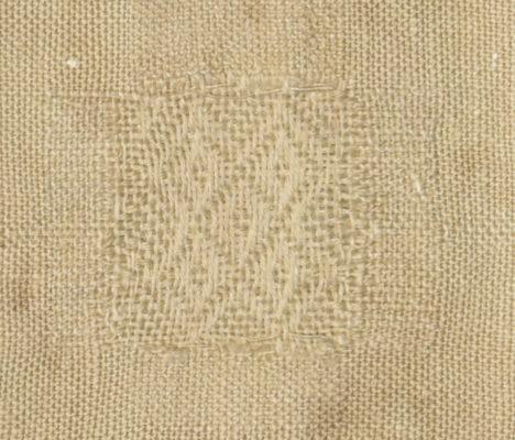 Detail of white diaper pattern.