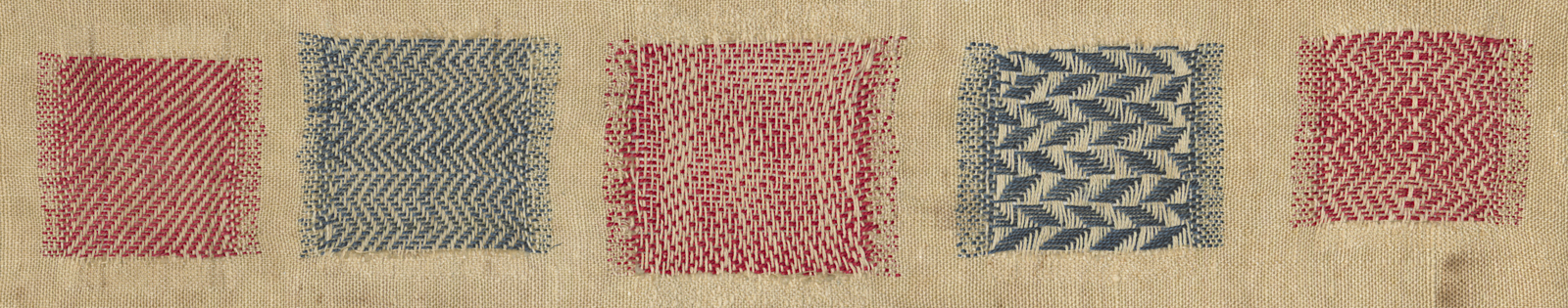 Detail of faux-weaving in the darning sampler, blue, red, and white.