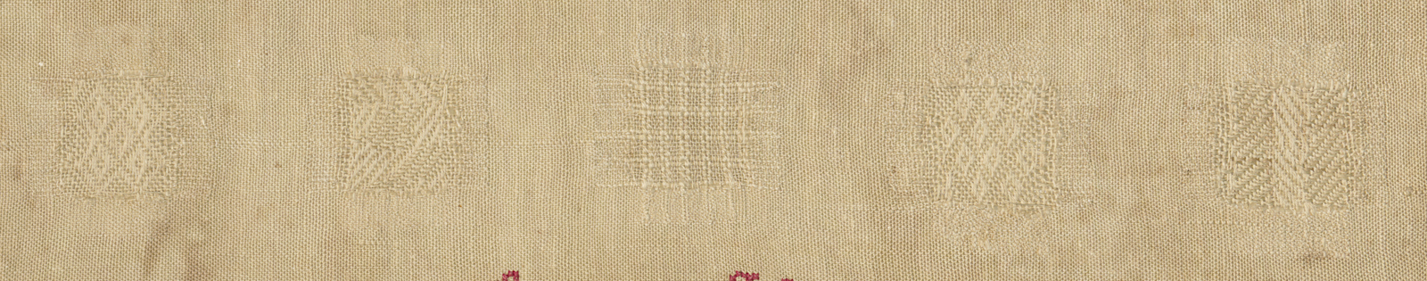 Detail of row of white stitches in the darning sampler.