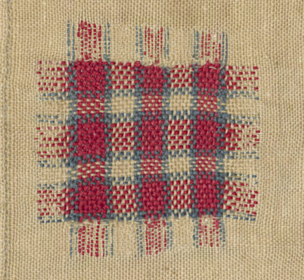 Detail of faux-woven plaid in red, white, and blue.
