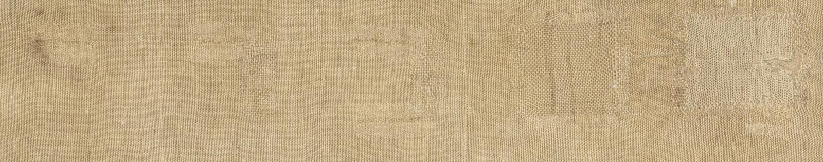 Detail of white mends in darning sampler.