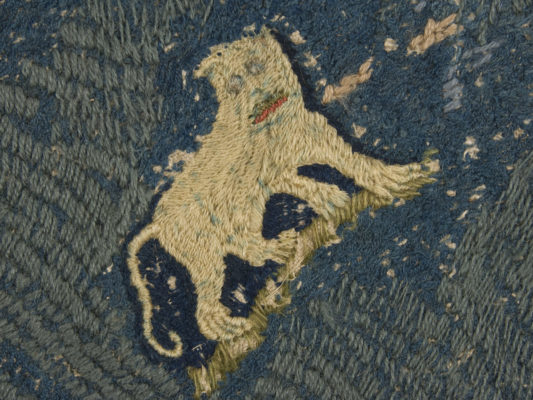 Detail of hearth rug, lion or dog.
