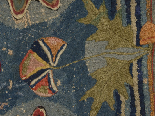 Detail of thistle on hearth rug.