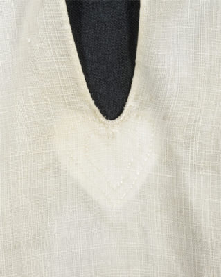 Detail of heart at the shirt front opening.