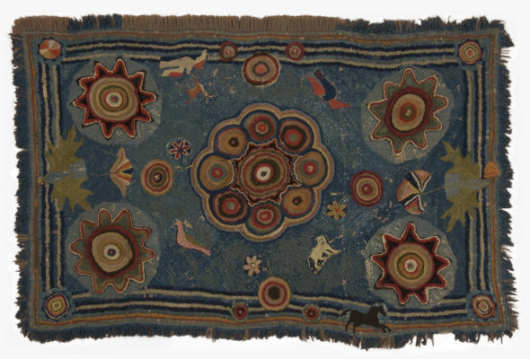 Full view of blue hearth rug with red, green, and blue circular elements, and flowers and animals.