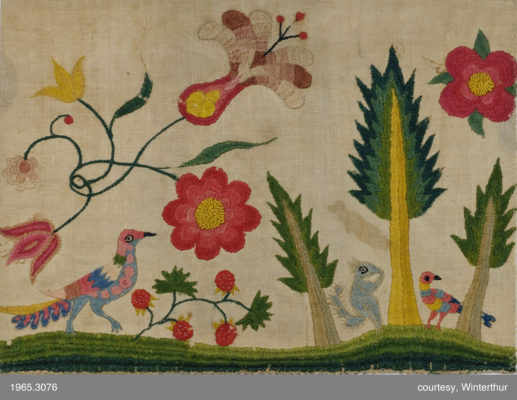 Detail of embroidery featuring two birds, a squirrel, and large flowers.