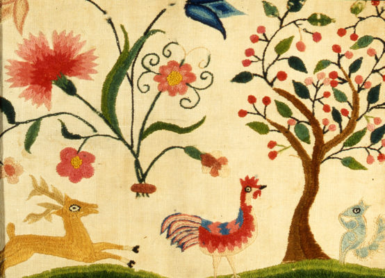 Detail of needlework featuring a deer and rooster, a squirrel , a tree, and flowers.