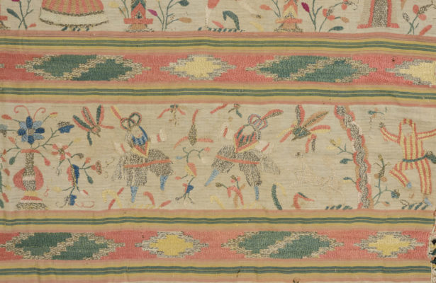 Detail of rebozo embroidery featuring three men.