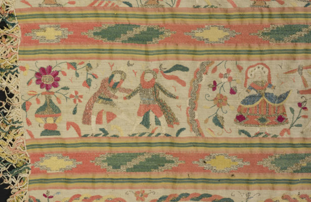 Detail of rebozo embroidery featuring two men and one woman in fancy dress.