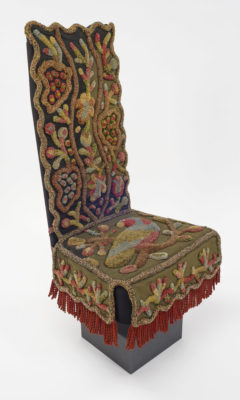 Three-quarters view of chair cover on form.