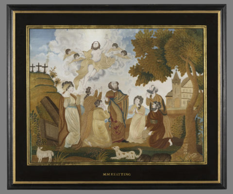 Religious needlework scene in frame.