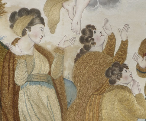 Detail of praying people with embroidered clothing and painted faces.