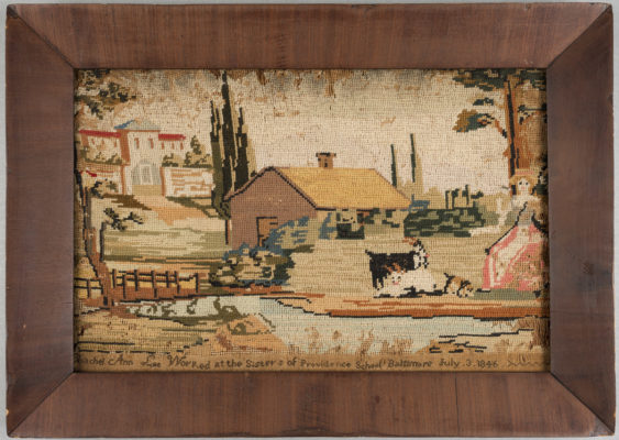 Needlework with manor, barn, goats, a woman, and a pond. In frame.