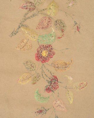 Detail of back of floral embroidery of the table cover.