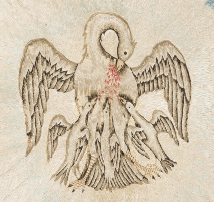 Detail of bedcover's central figures. Mother pelican feeds three young birds with blood from her breast.