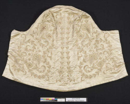 Mantle exterior, with intricate embroidery.